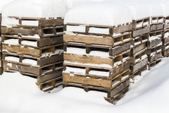 Construction pallets in the snow Stock Photo