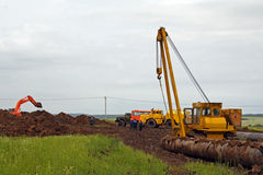 Construction of the pipeline. The tractor works on construction of the pipeline royalty free stock photography