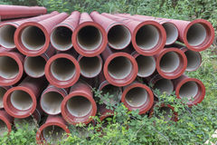 Construction pipes at a construction site in the forest Stock Image