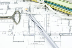 Construction plan closeup with old key, pencil and hard desks. Architecture theme background stock photo