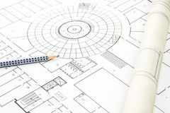 Construction plan closeup with pencil and rolled paper Stock Photos