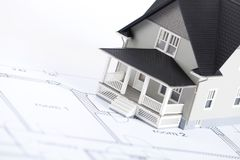 Construction plan with house architectural model stock images