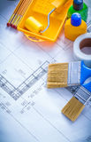 Construction plan with paint roller tray brushes Royalty Free Stock Photos