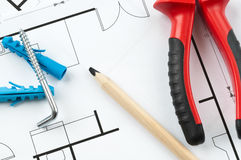 Construction Plan Tools. Building plan with selection of construction tools Royalty Free Stock Photos