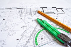 Construction planning. Drawing utensils on a blueprint Stock Photography