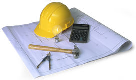 Construction planning on dark background. Hard hat, blueprints, hammer, calculator, caliper on white background Royalty Free Stock Photos
