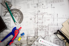 Construction planning drawings on the table with pencils, ruler Royalty Free Stock Photo