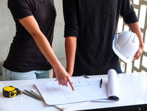 Construction planning. Two engineers are inspecting construction and construction planning Stock Images