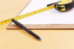 Construction Plans. With Measuring Tape And Pen Royalty Free Stock Photos