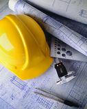 Construction plans. With hard hat and drawing tools stock photography