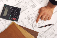 Construction plans. Man show construction plans at the table stock photos