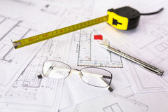 Construction plans on blueprints. And measure Stock Image