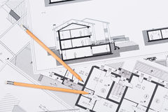 Construction plans with drawing tools on blueprints Royalty Free Stock Photo
