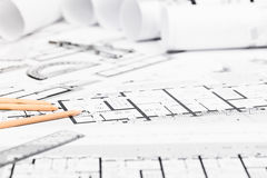 Construction plans with drawing tools on blueprints Royalty Free Stock Image