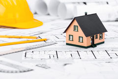 Construction plans with drawing tools House Miniature and Safety Royalty Free Stock Photography