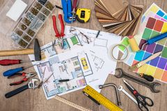 Construction plans with drawing tools. And work tools Stock Photo