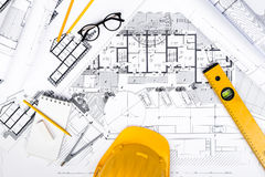 Construction plans with drawing and working Tools on blueprints Stock Images