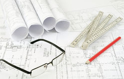 Construction plans and glasses Stock Photo