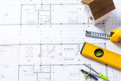 Construction plans with helmet and drawing tools on blueprints Stock Photography