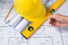Construction plans with helmet and drawing tools on blueprints Stock Photos