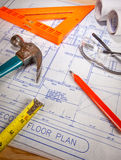 Construction plans. And measurement tools royalty free stock photography