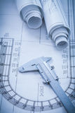 Construction plans metal vernier caliper on Royalty Free Stock Images