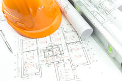 Construction plans and orange helmet Royalty Free Stock Photos