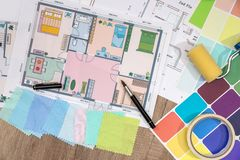 Construction plans with Paint Brush and Colors Palette. Building and Construction. Industry Concept royalty free stock photo