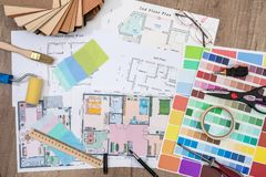 Construction plans with Paint Brush and Colors Palette. Building and Construction Industry Concept Royalty Free Stock Photos