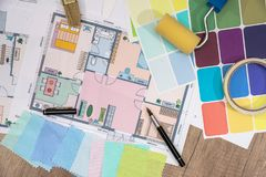 Construction plans with Paint Brush and Colors Palette. Building and Construction Industry Concept stock photo