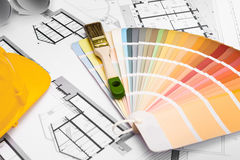 Construction plans with Paint Brush Colors Palette and Yellow Sa. Fety Helmet on blueprints; Building and Construction Industry Concept stock photos
