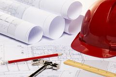 Construction plans with red helmet and drawing tools Stock Photo