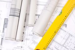 Construction Plans and ruler. Construction plans of interior and ruler. Studio Shot royalty free stock image