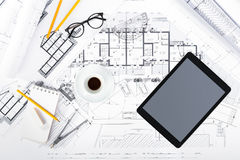Construction plans with Tablet and drawing Tools on blueprints Stock Image