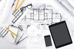 Construction plans with Tablet and drawing Tools on blueprints. Top View of Construction plans with Tablet, smart phone and drawing Tools on blueprints Stock Image