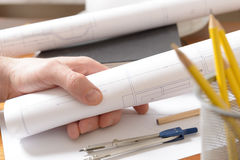 Construction plans and tools. Construction plans in hand and drawing tools Stock Image