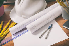 Construction plans and tools. Construction plans with helmet and drawing tools on blueprints and measure Stock Images