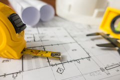 Construction plans with White helmet and drawing tools on bluepr Stock Images