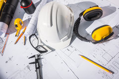 Construction plans with White helmet and drawing tools on bluepr Royalty Free Stock Photos