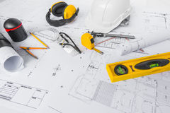 Construction plans with White helmet and drawing tools on bluepr Royalty Free Stock Photo