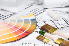 Construction plans with whitewashing Tools and Colors Palette. On blueprints; Building and Construction Industry Concept stock images