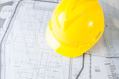 Construction plans with yellow helmet Royalty Free Stock Photo