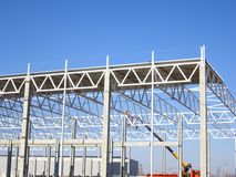 Construction of a metal frame plant stock photography