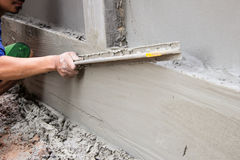 Construction Plaster work. Work construction Plaster Tool in site Stock Photo
