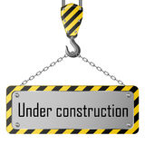 Construction plate with crane hook and chain Royalty Free Stock Image