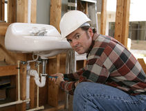 Construction Plumber Working Royalty Free Stock Images
