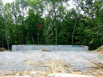 Construction - Poured Concrete Foundation. The concrete foundation has been poured and awaits the arrival of the framing package for the house that is being royalty free stock photography