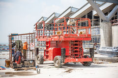 Construction of premises. With construction materials, bricks, beams, winches and scaffolding Royalty Free Stock Photography
