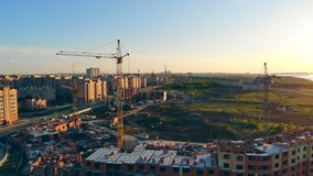 Construction site from above. Construction process of an urban appartments. Construction process of an urban neighborhood. 4K stock footage