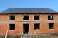 Construction in Progress. New home under building construction with insulating tiles on the exterior, awaiting render along with installation of windows and Stock Images